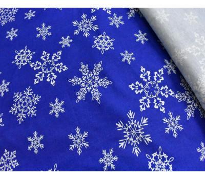 "1855 Ткань с рисунком ""Снежинки"" на синем вид 1"